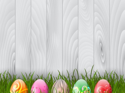 Derative Easter Eggs In Grass On A Wood Background