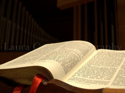 Closeup Of Open Bible On Dark Background With